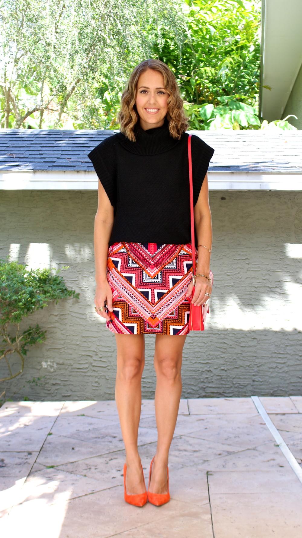 Black turtleneck with tribal skirt and orange heels