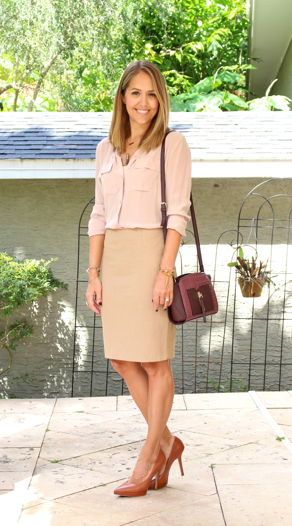 Blush top, khaki skirt, burgundy purse