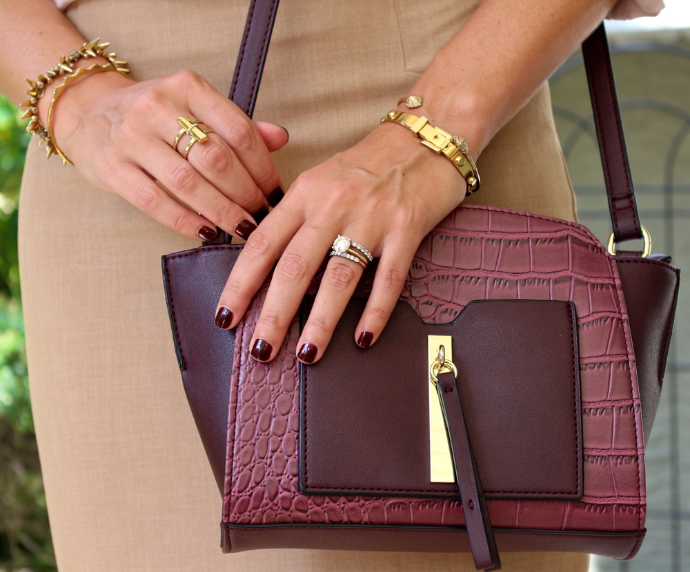 Burgundy purse with khaki skirt