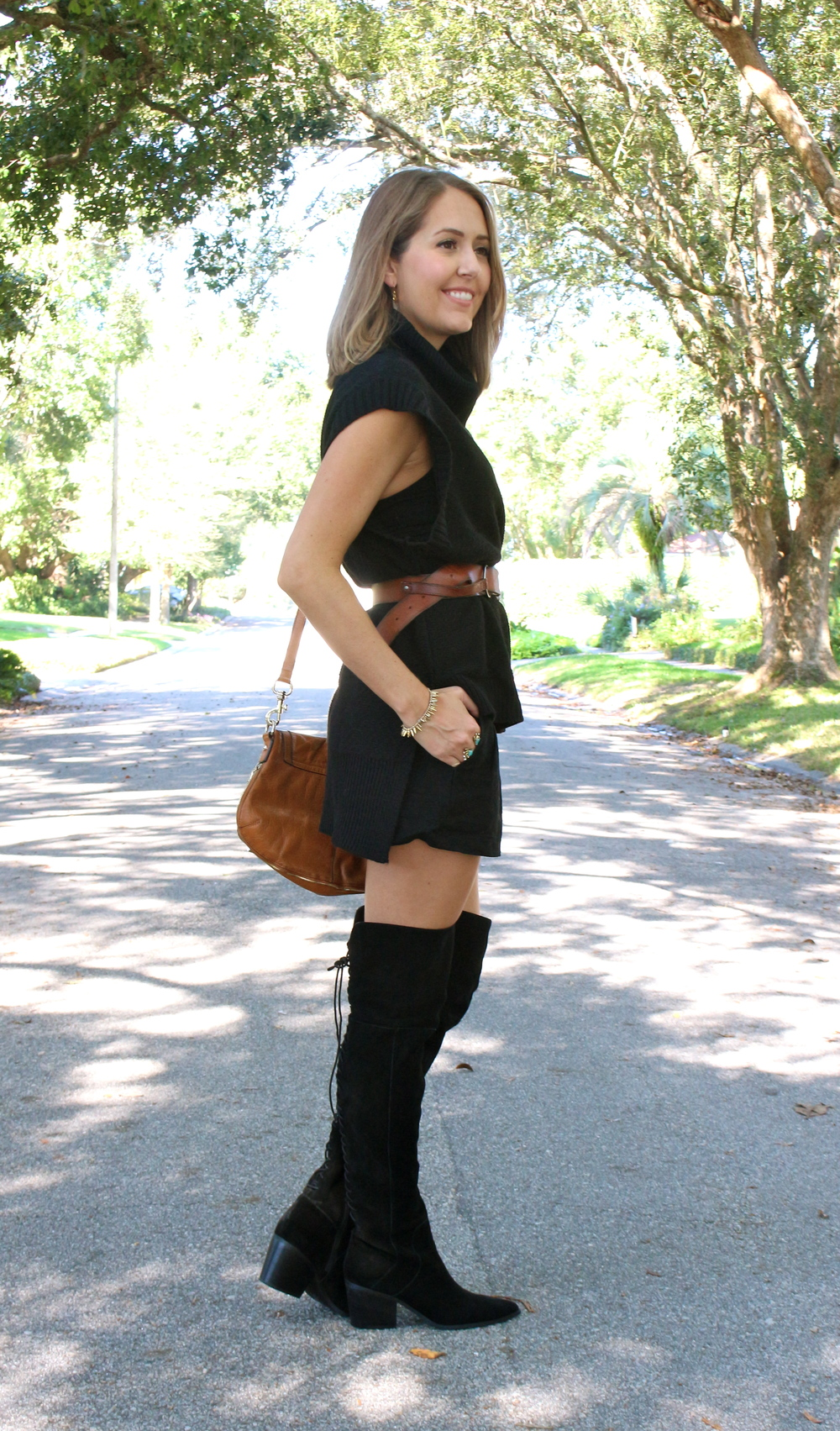 Black turtleneck with black shorts and black boots