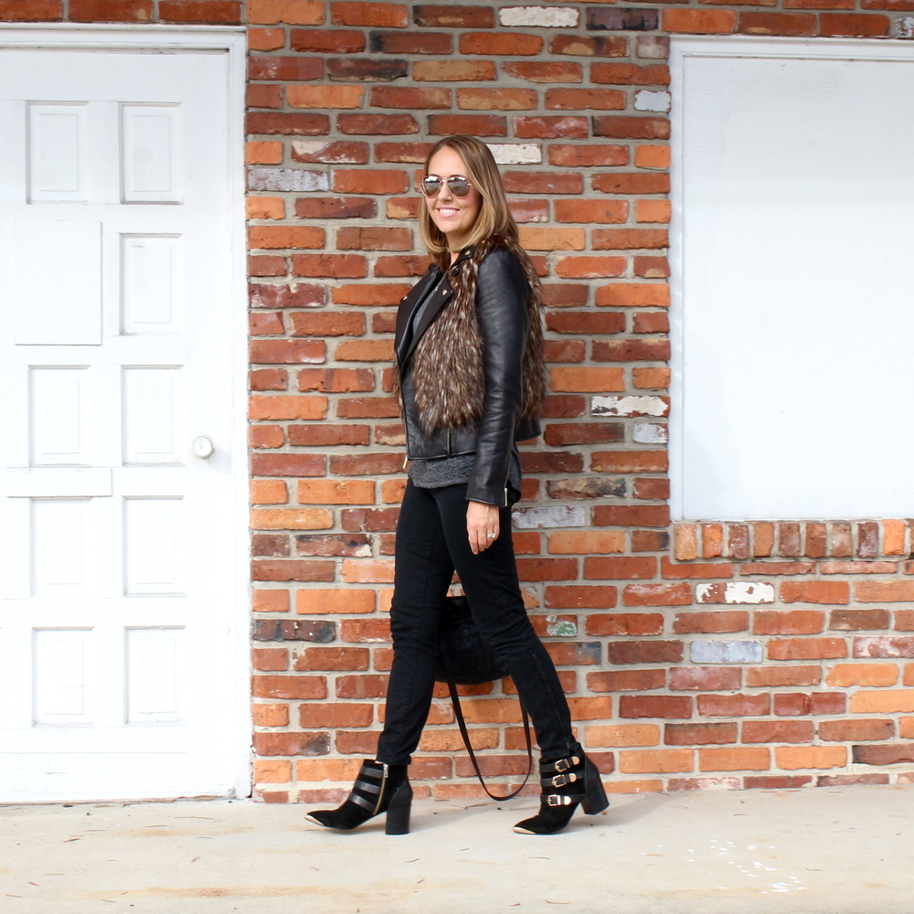 Faux fur vest, black leather jacket, black jeans