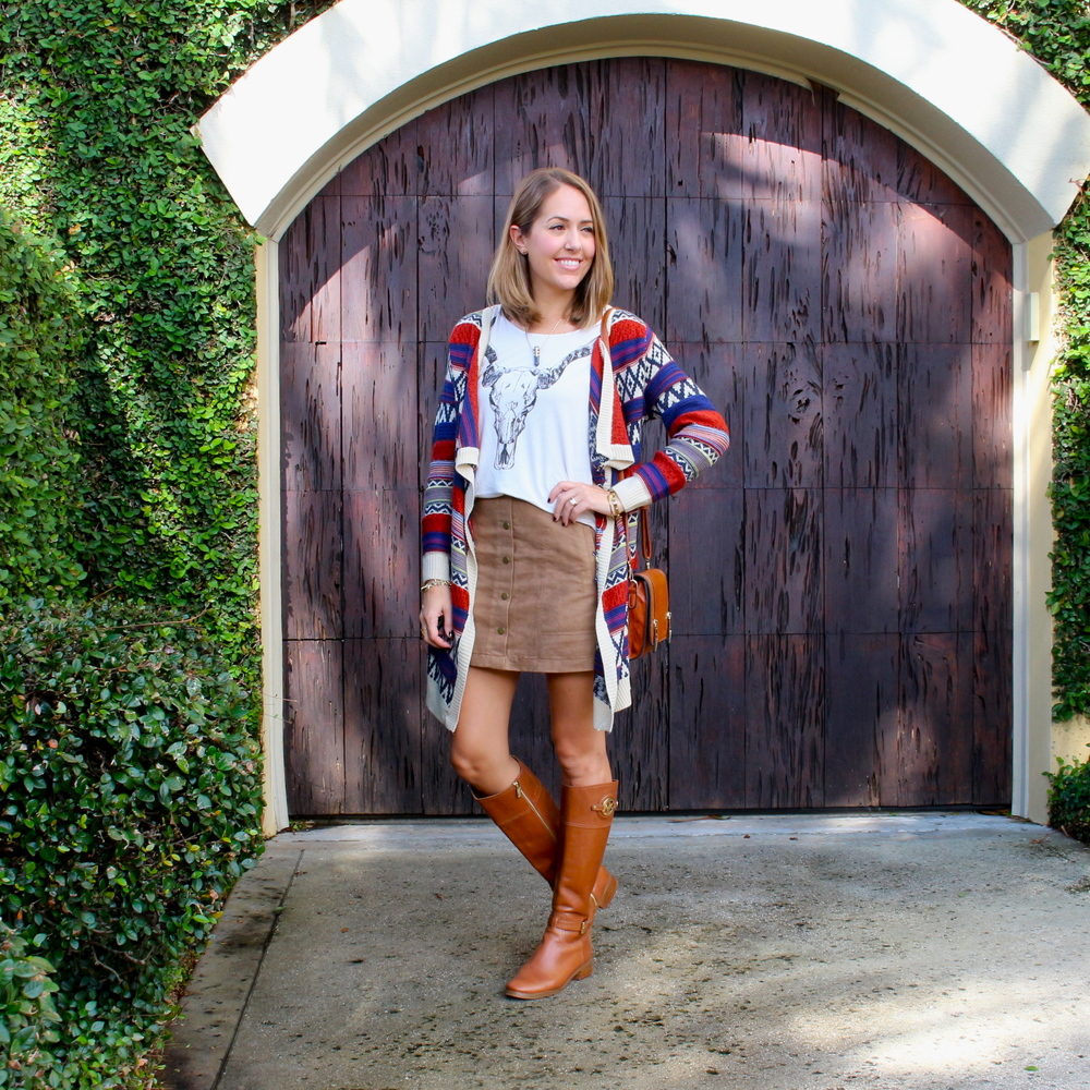 Printed cardigan, graphic tee, suede skirt, riding boots