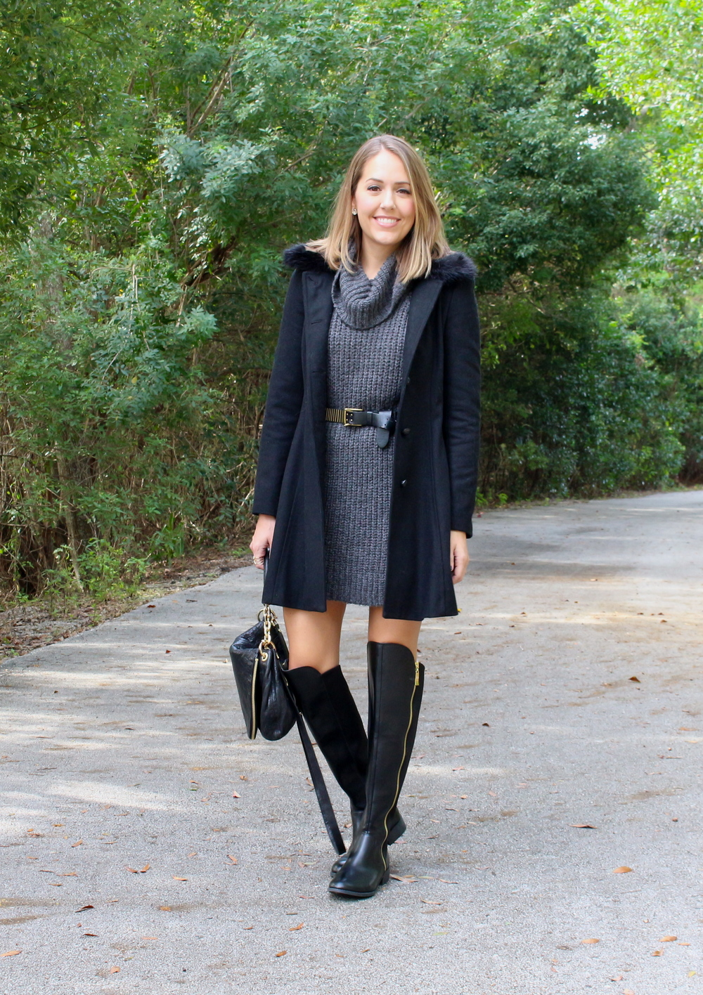 Black coat, gray sweater dress, black boots