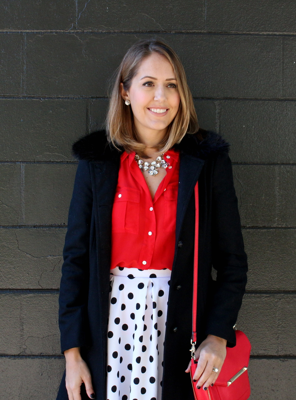 Polka dot skirt, red shirt, black wool coat