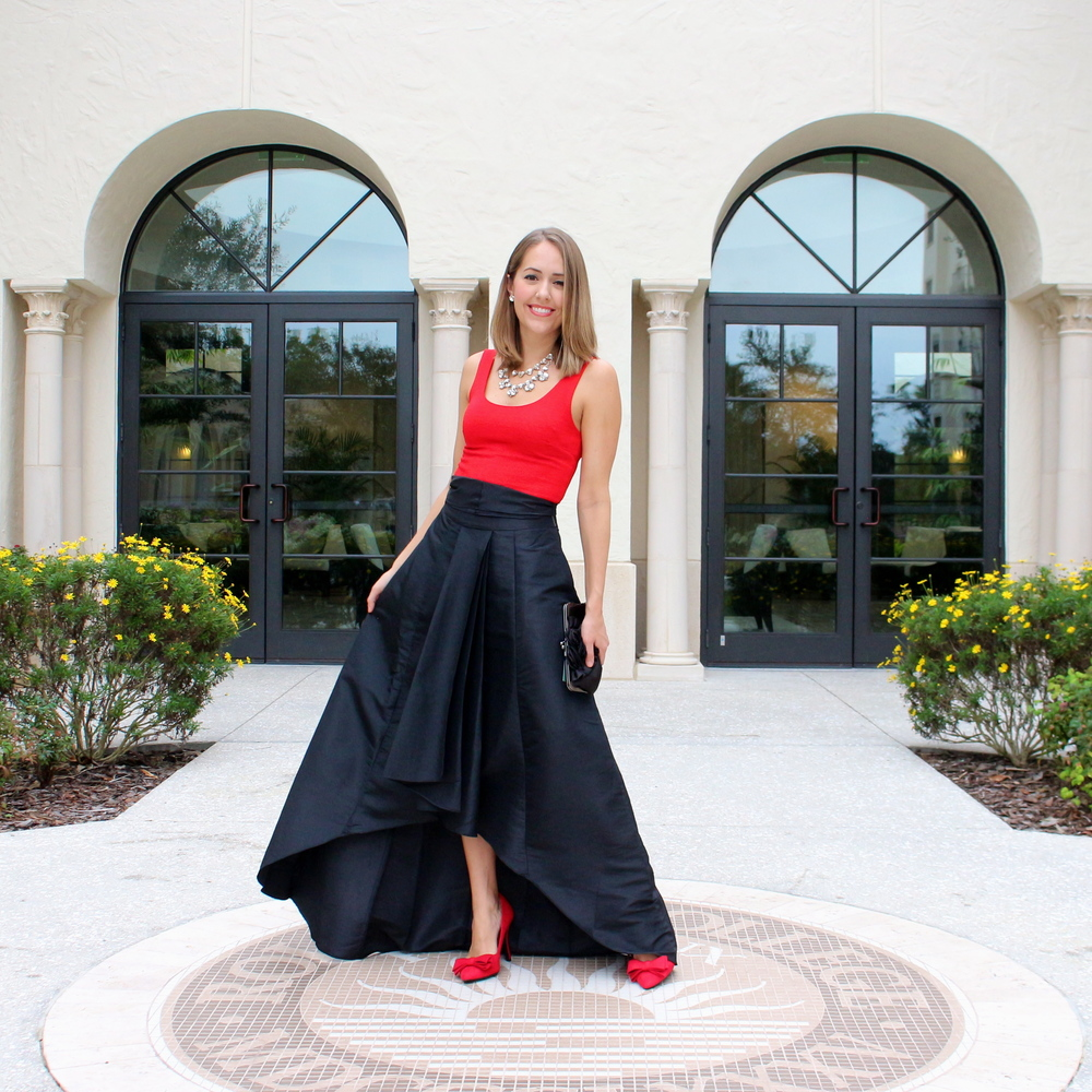 Red tank, black taffeta skirt, red bow pumps