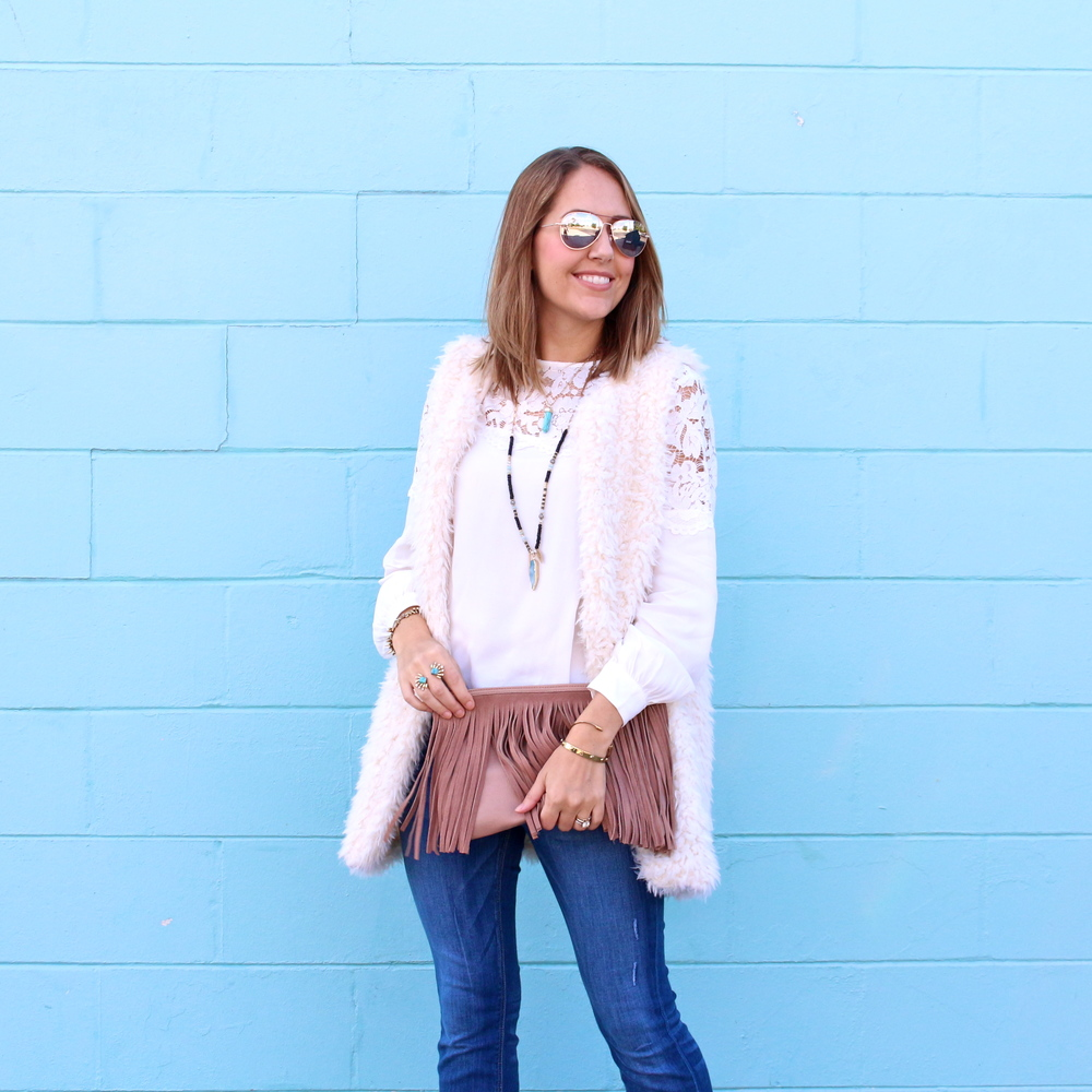 Fuzzy vest, lace yoke top, flare jeans, turquoise jewelry