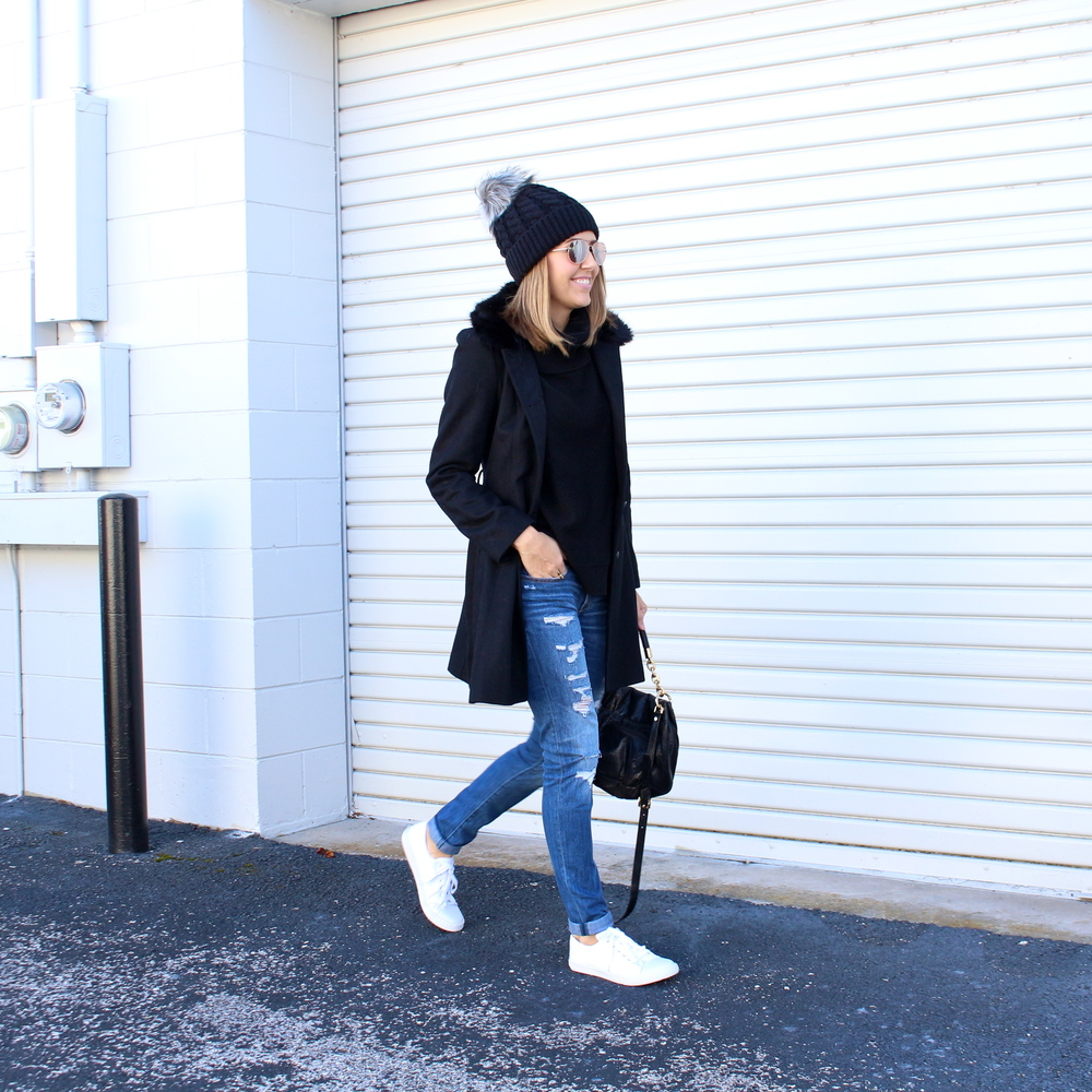 Beanie, black coat, white sneakers