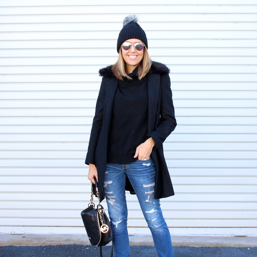 Black beanie, black turtleneck, black coat