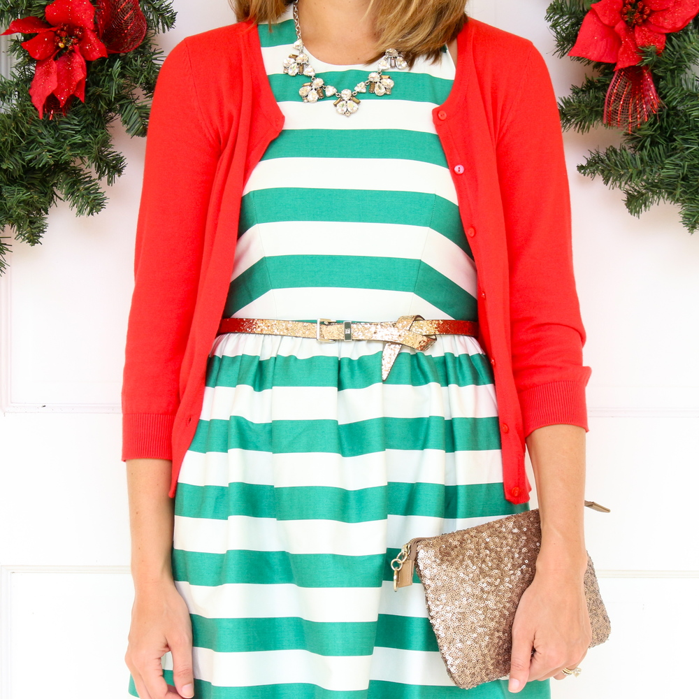 Green stripe dress, red cardigan, gold glitter belt and clutch