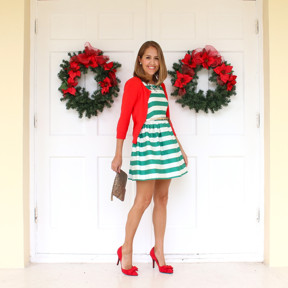 Red cardigan, green striped dress, red bow pumps