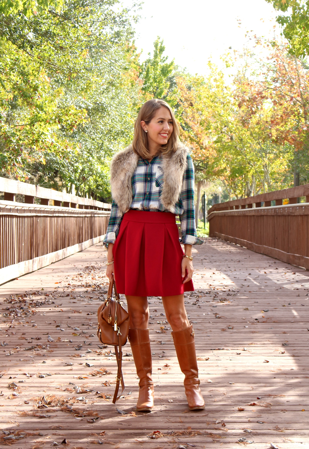 Plaid top, red skirt, riding boots
