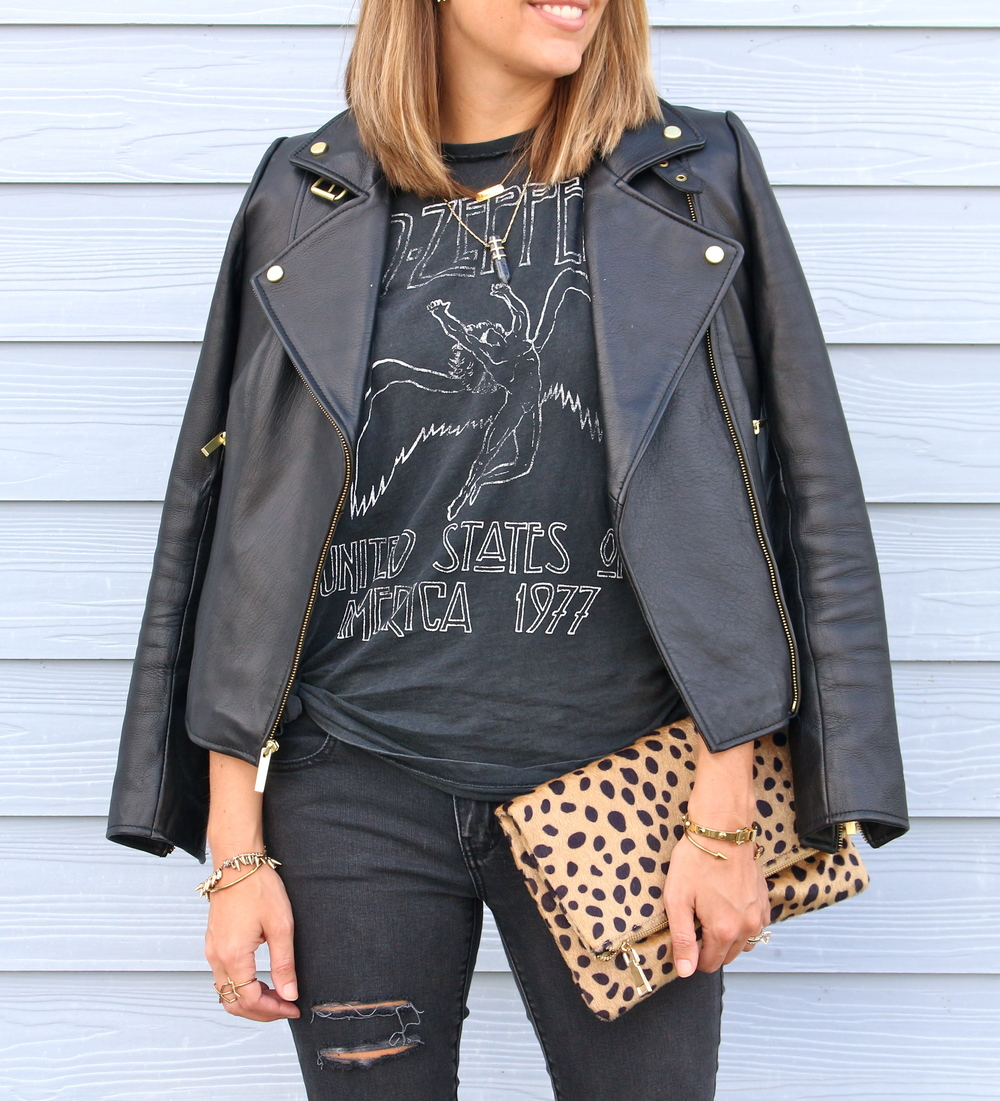 Leather jacket, graphic tee, leopard clutch