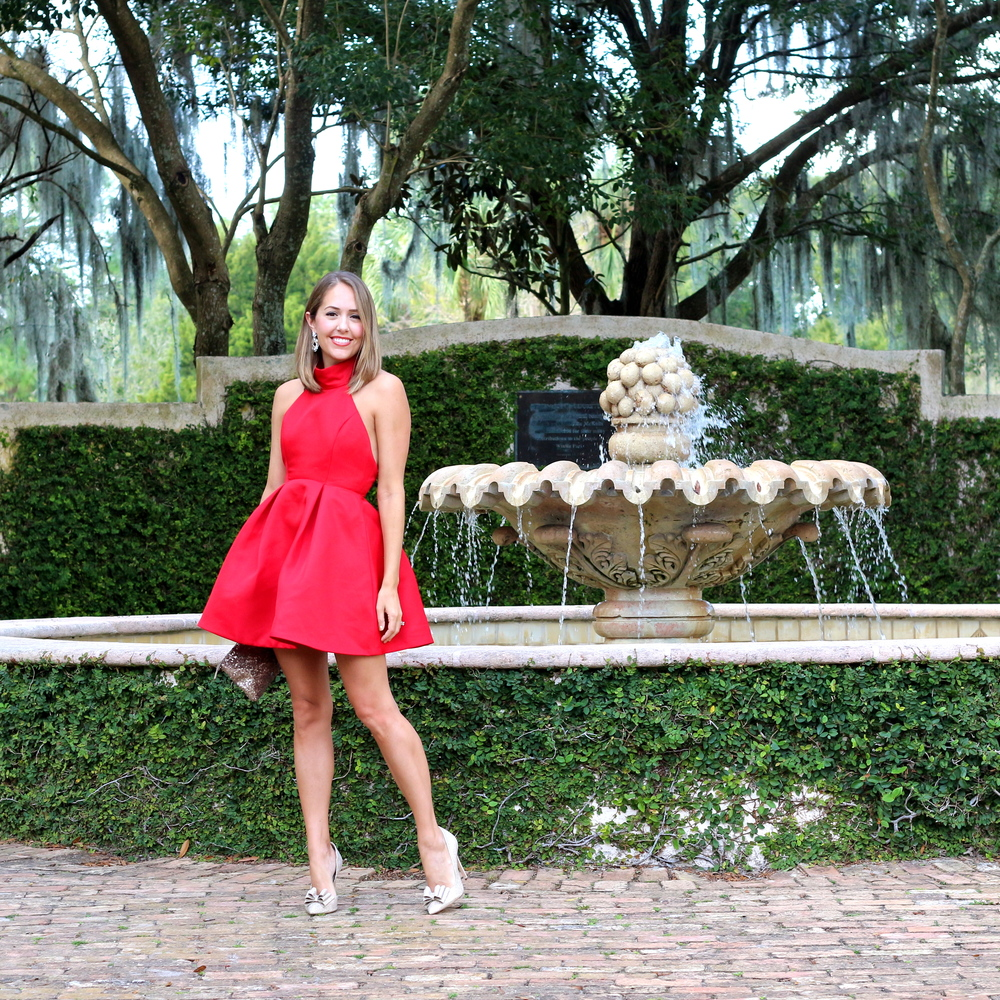 Red halter dress, gold bow pumps