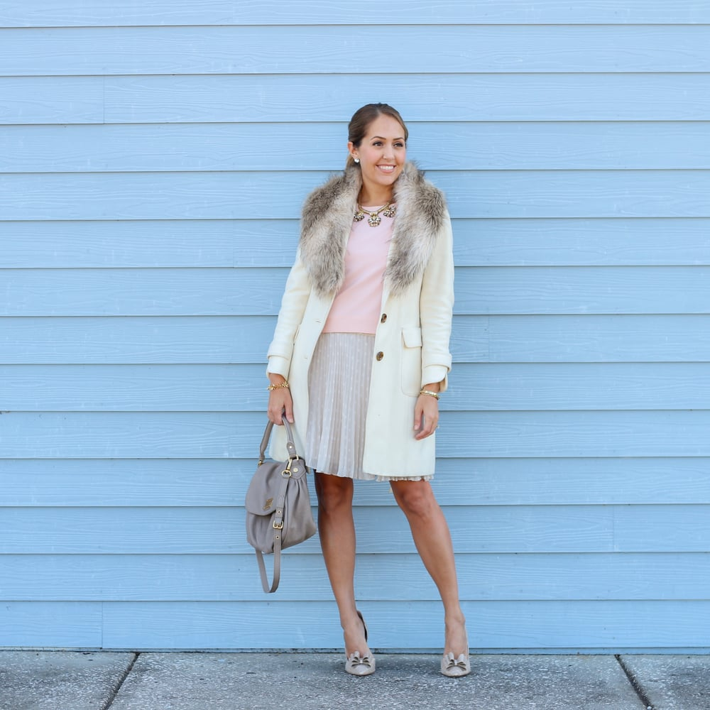 Faux fur collar, ivory coat, blush top, pleated skirt
