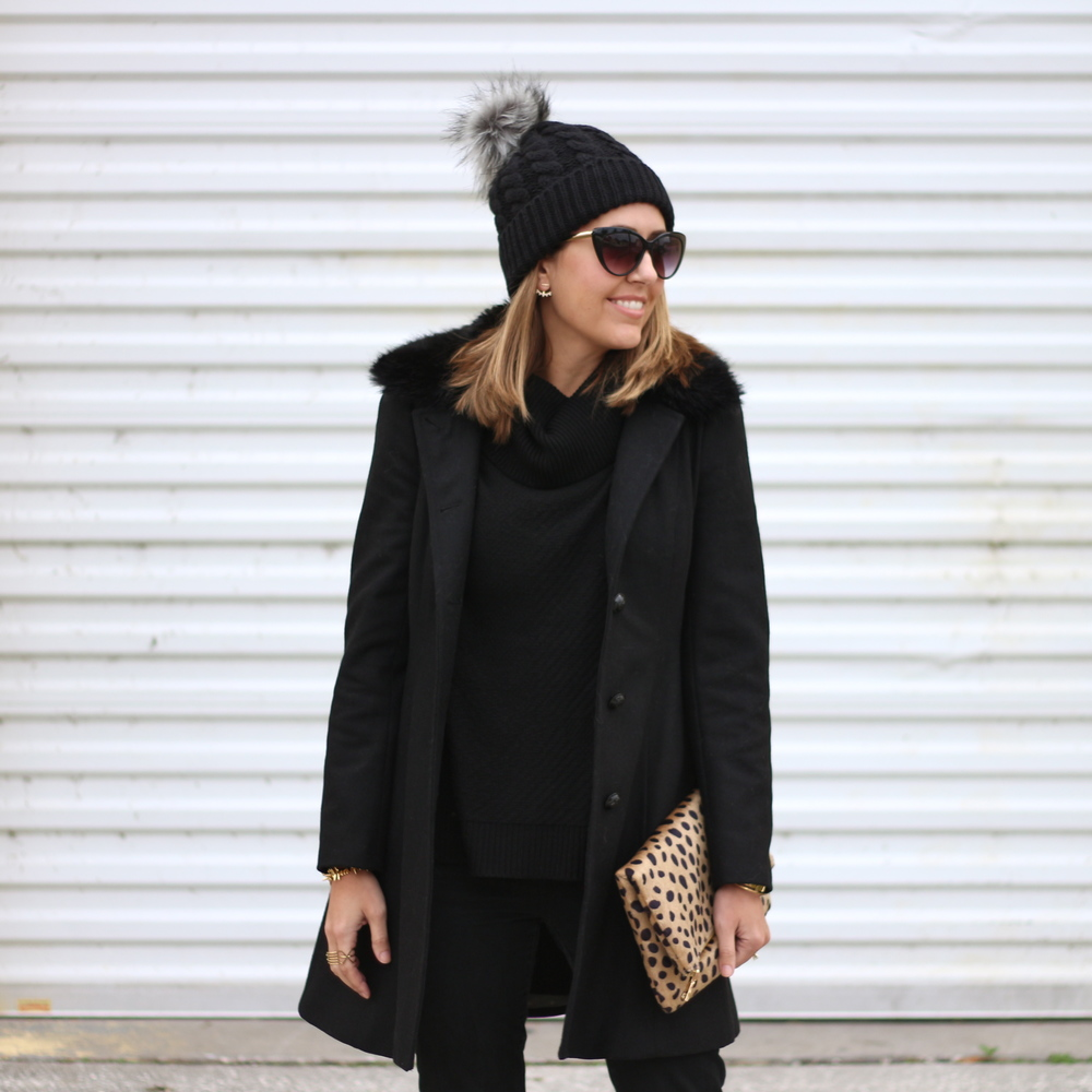Black coat, leopard clutch, black beanie