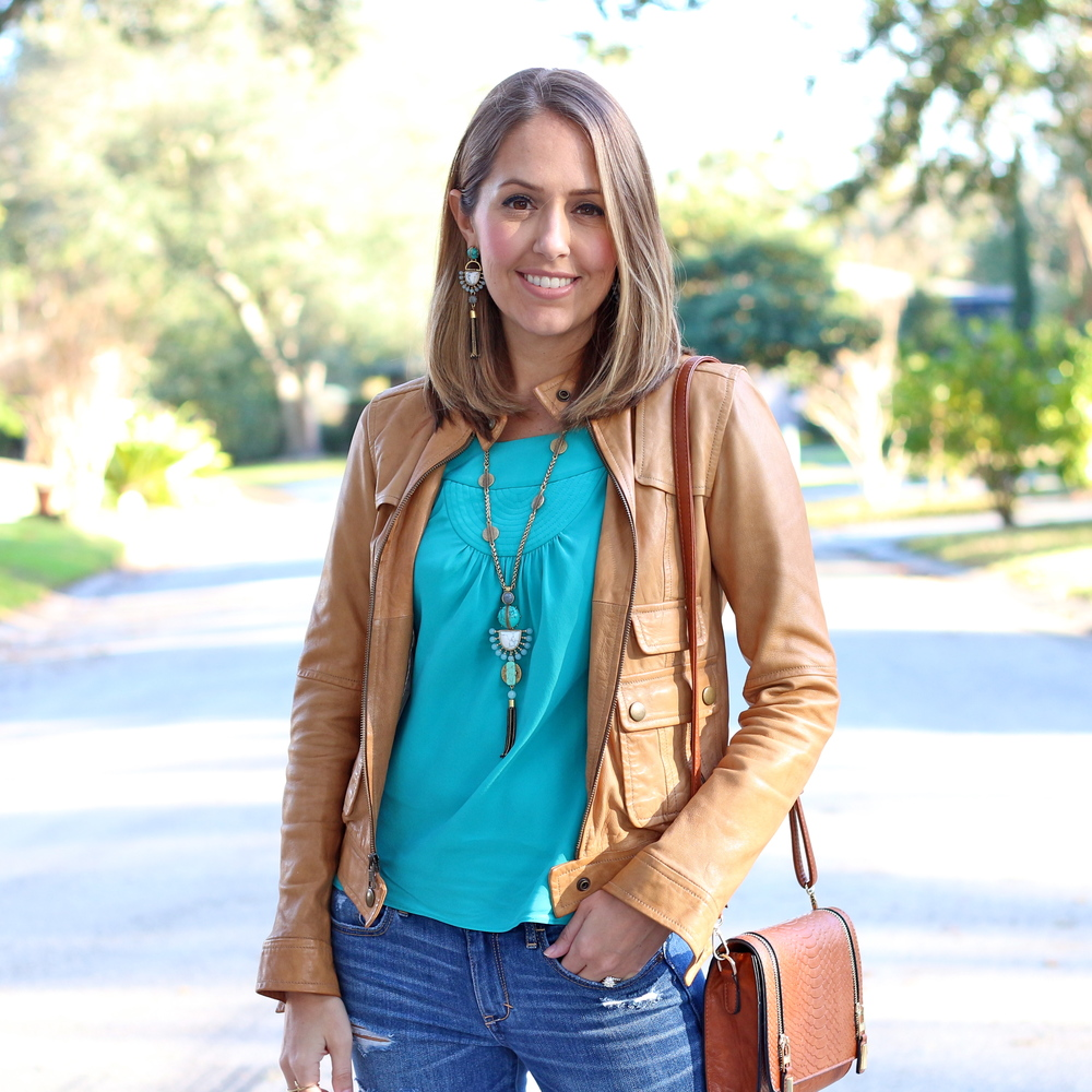 Turquoise necklace and top with cognac leather jacket