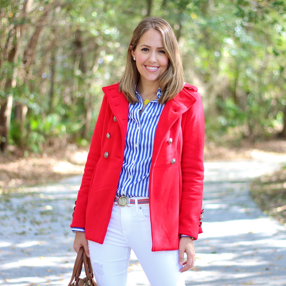 Red coat, blue striped shirt, white jeans