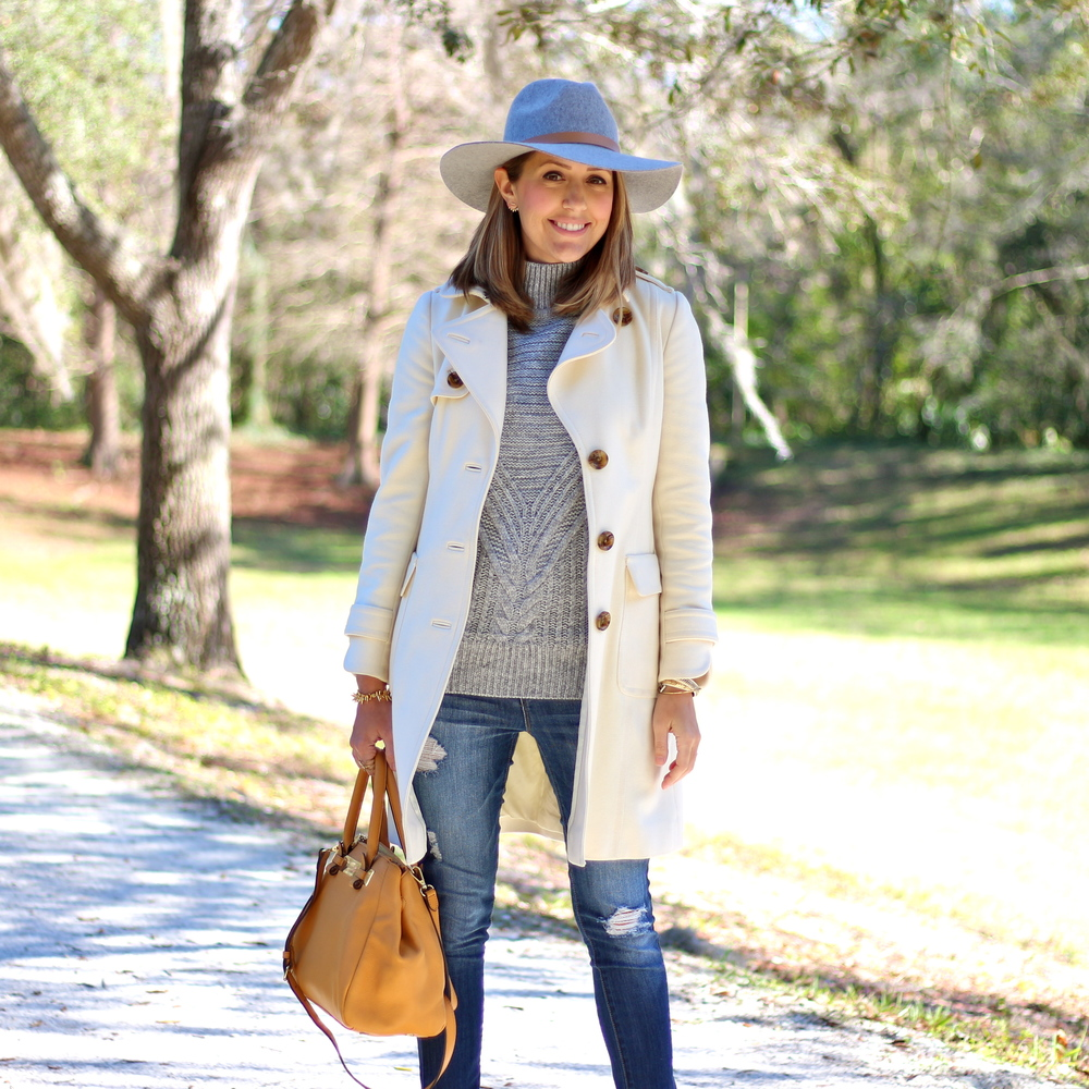 Gray wool hat, gray turtleneck, ivory coat