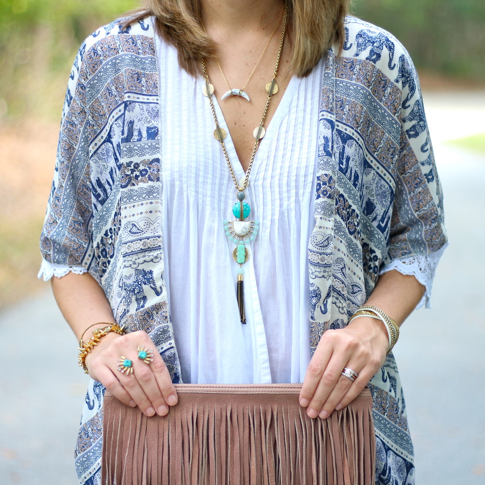 Elephant print cardigan over white top