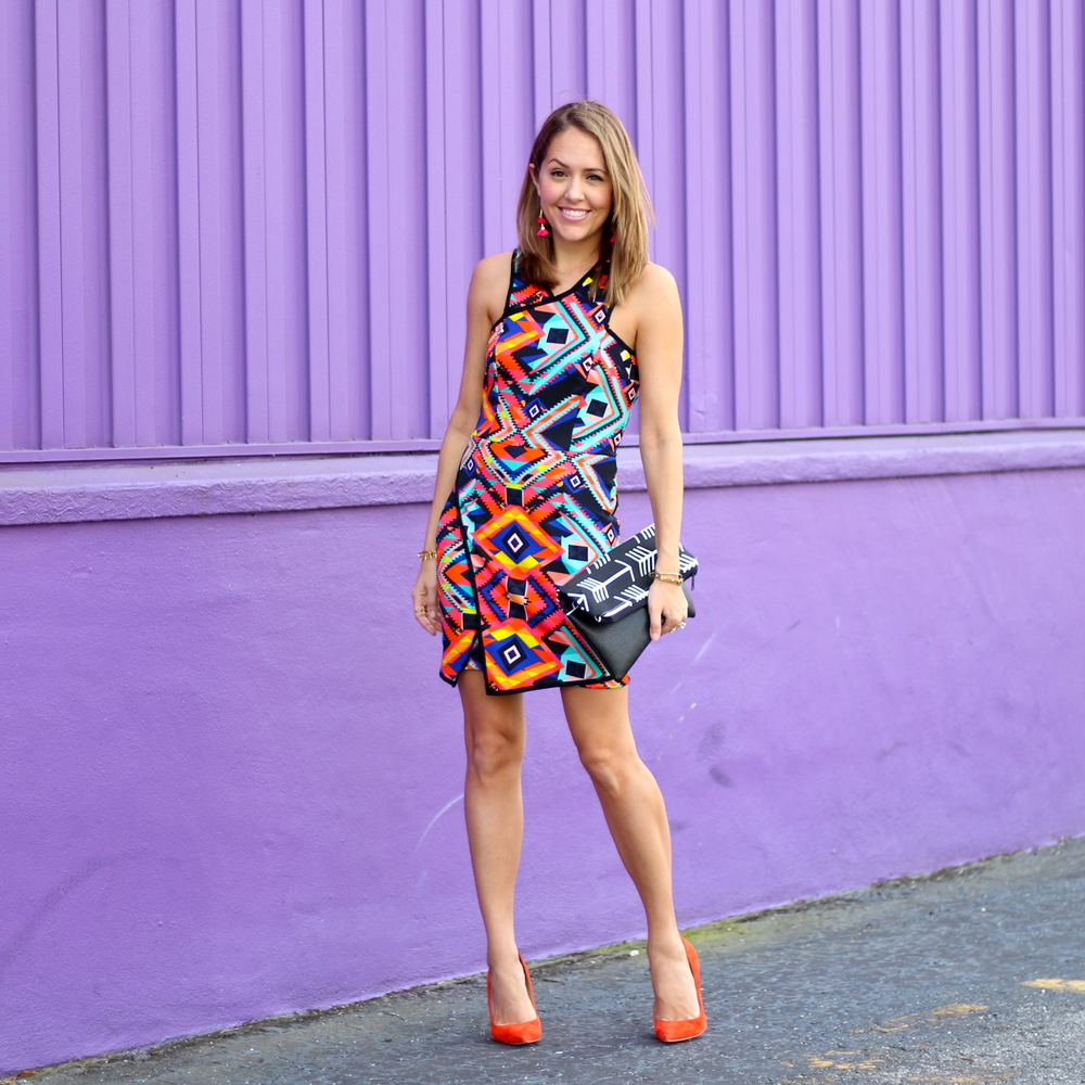 Asymmetrical tribal print dress, orange pumps