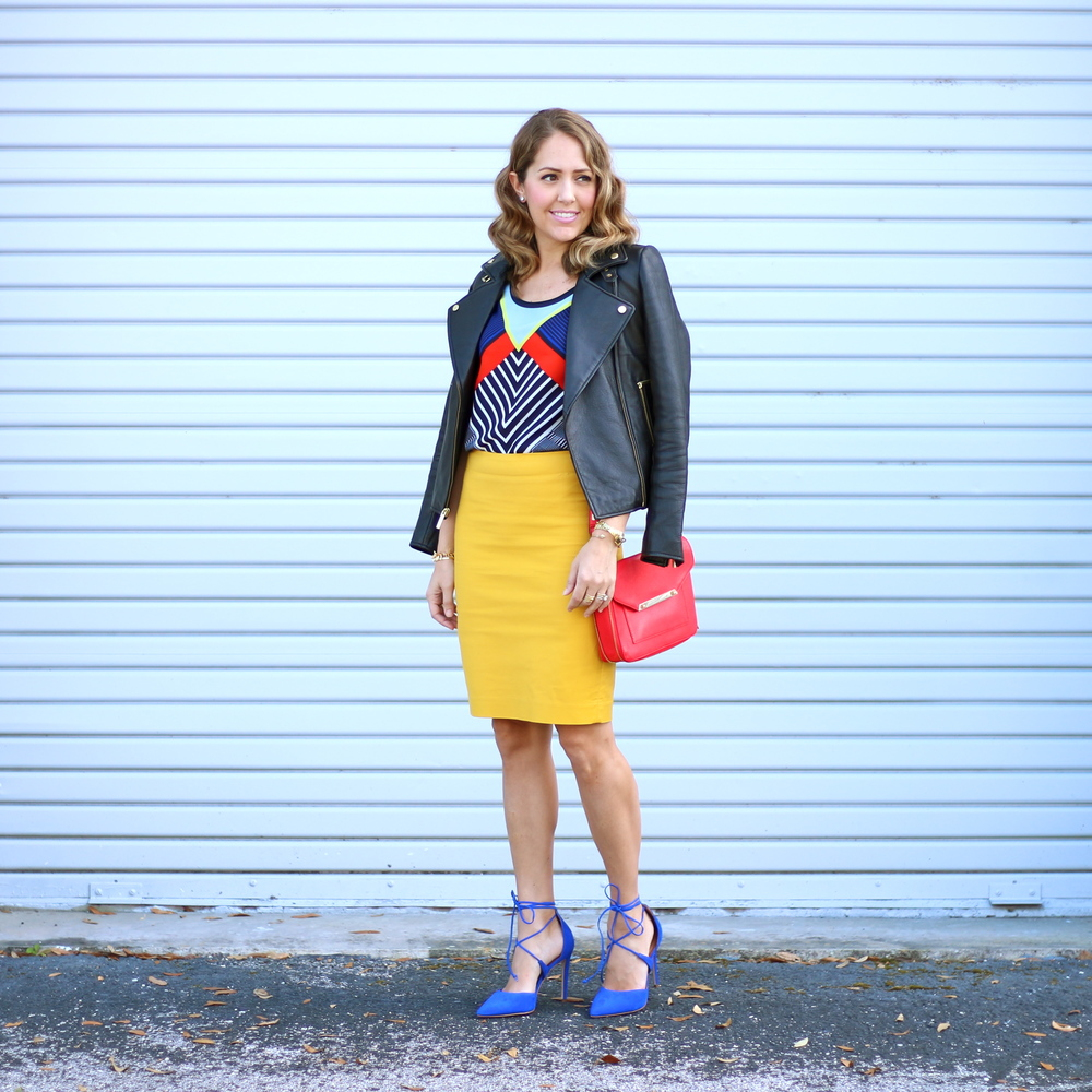 Leather jacket, geographic top, yellow skirt, cobalt heels