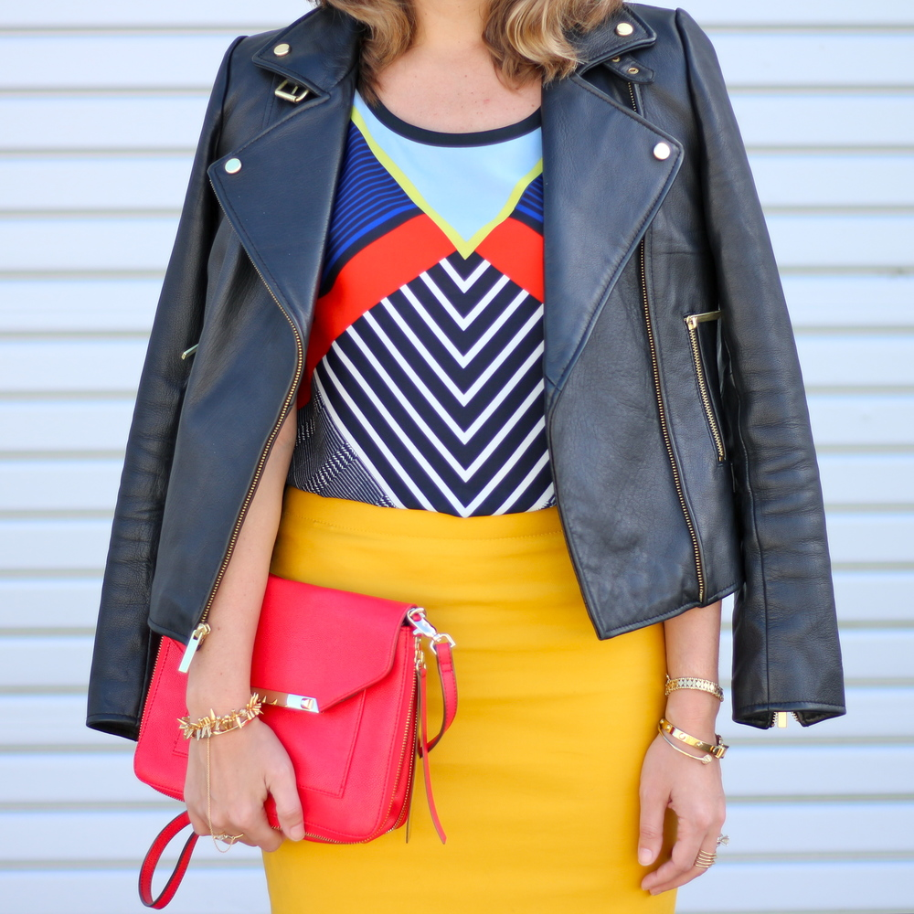 Leather jacket, geographic top, yellow skirt