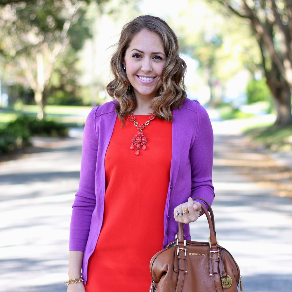 Purple cardigan, red dress, red necklace