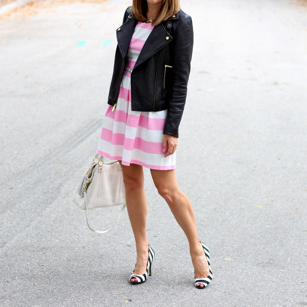 Pink stripe dress, leather jacket, black striped shoes