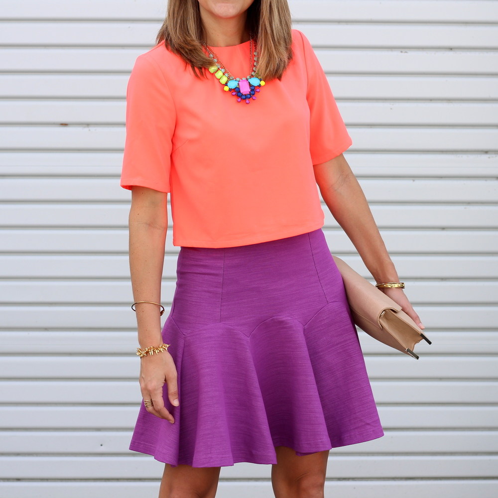 Orange crop top, purple flare skirt