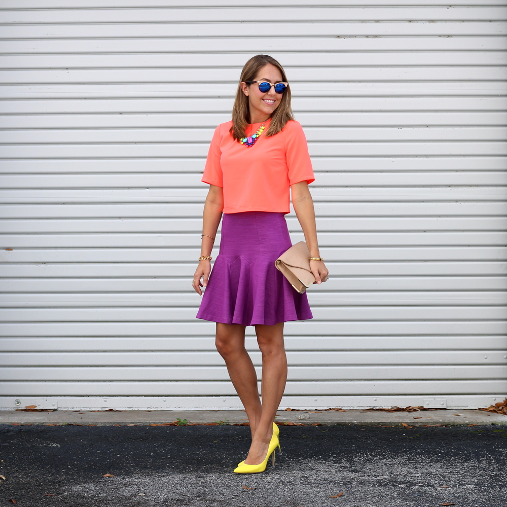 Orange crop top, purple flare skirt, yellow pumps