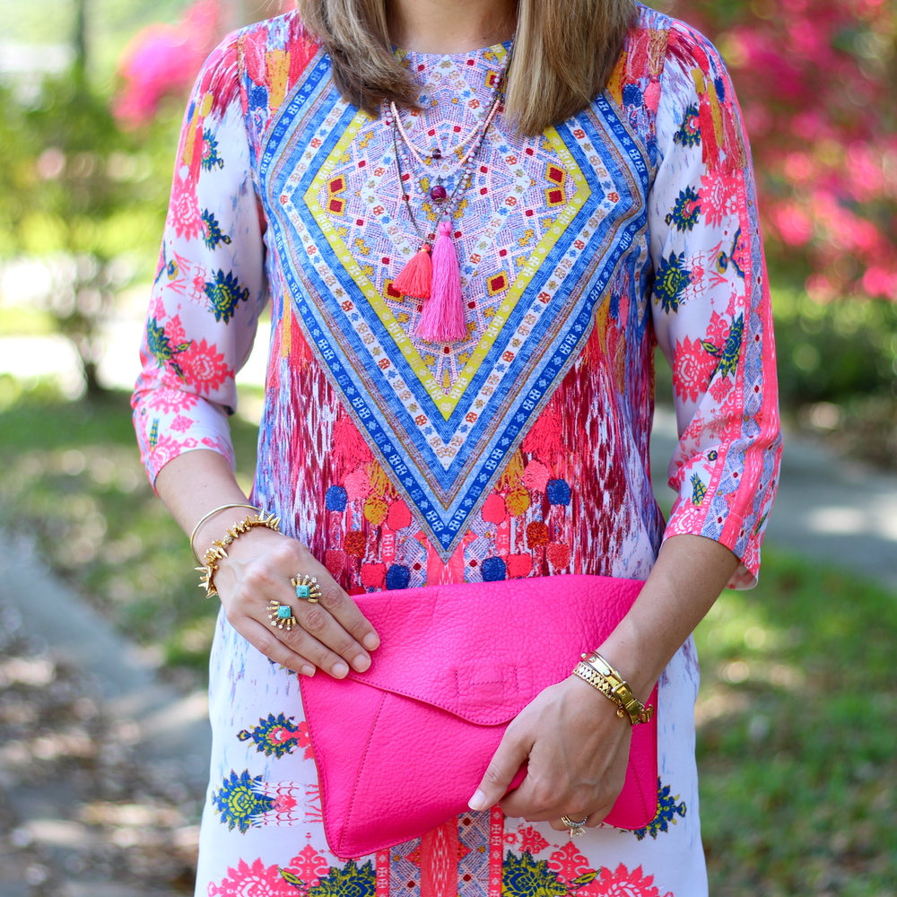 GB dress, tassel necklaces, hot pink clutch
