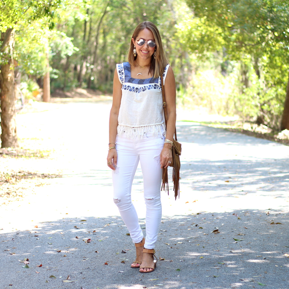 Embroidered fringe top, white jeans, fringe purse