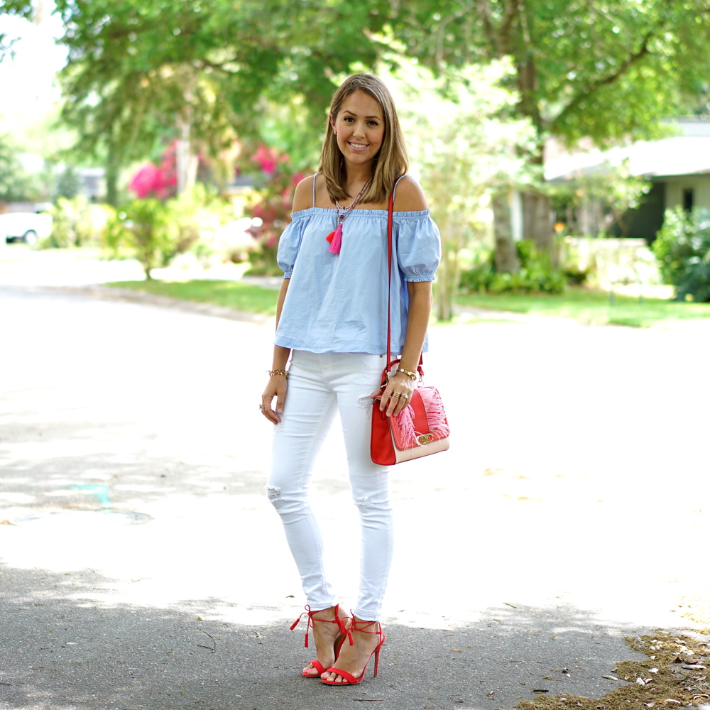 Blue off shoulder, white jeans, red shoes