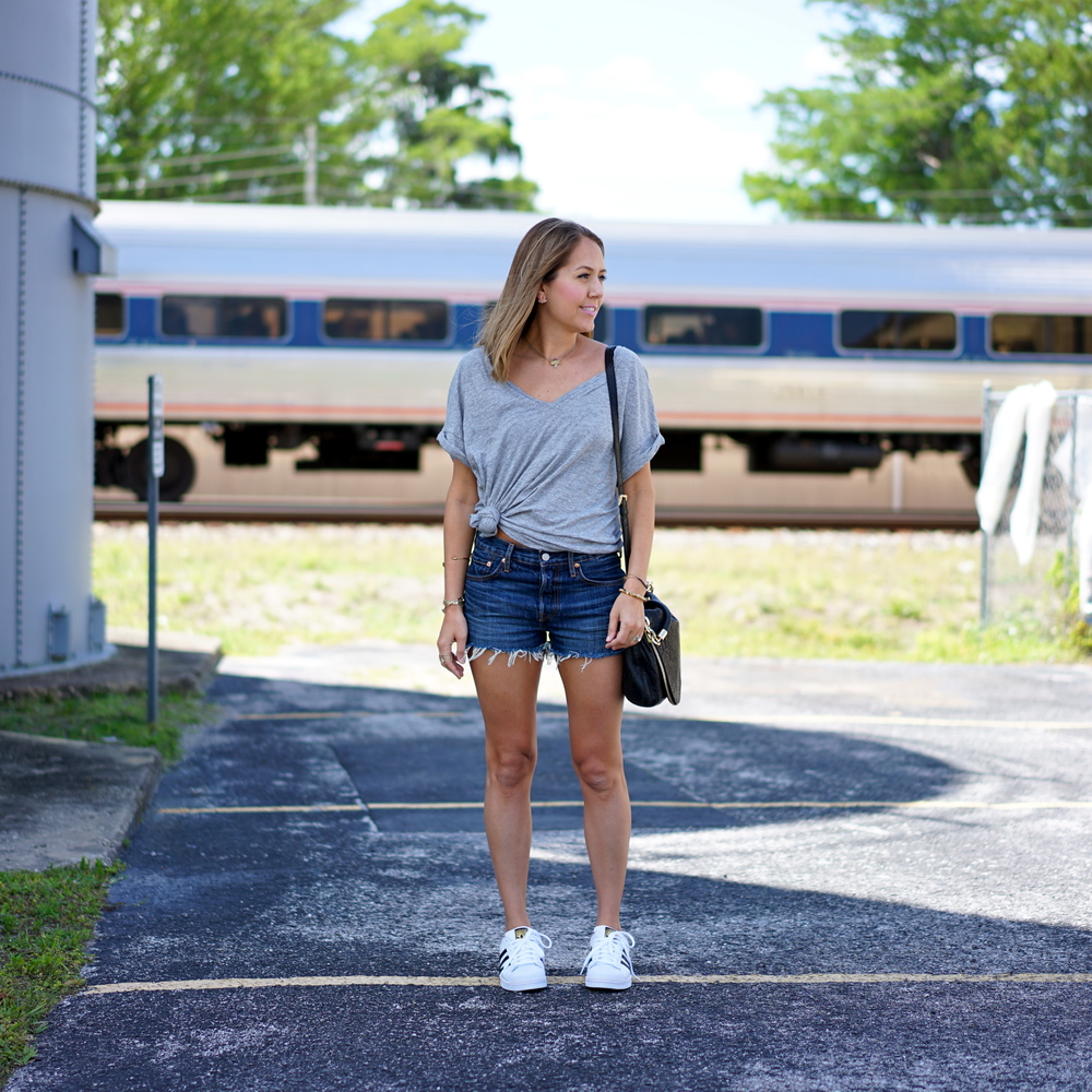 Gray v-neck tee, Levi's denim shorts, Adidas sneakers