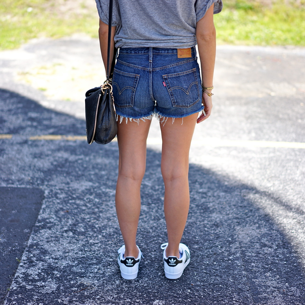Levi's denim shorts, Adidas sneakers