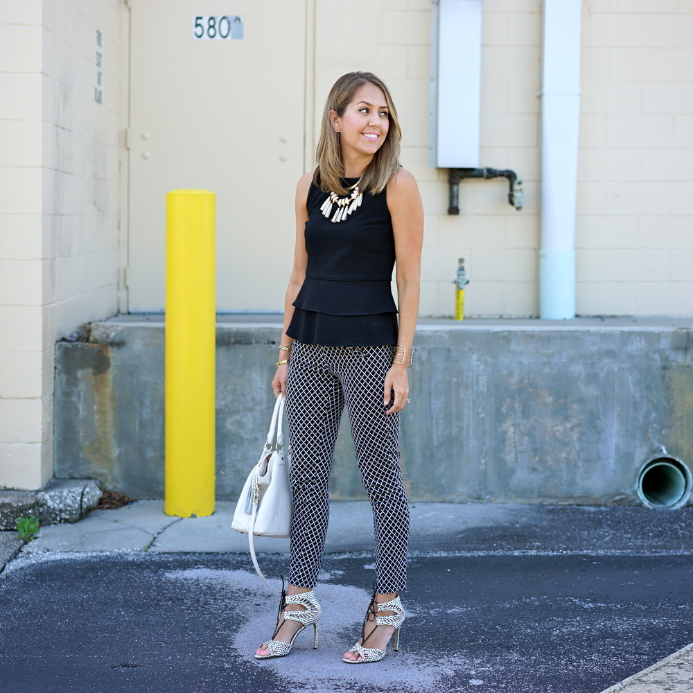 Black peplum top, printed pants, lace up printed heels