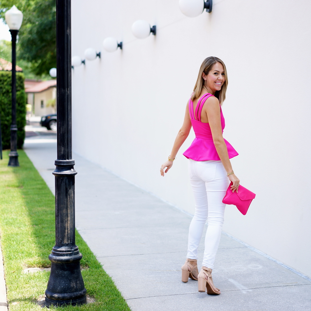 Hot pink peplum, white jeans