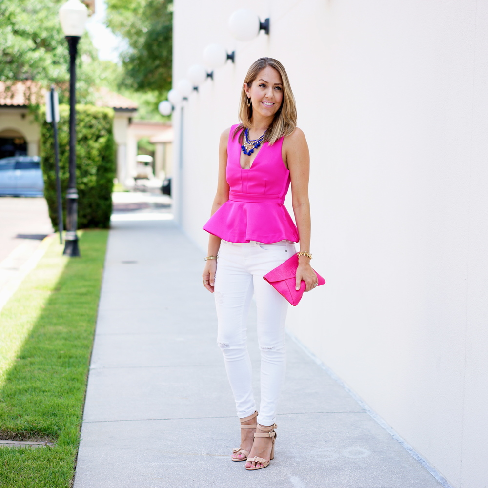 Hot pink peplum, white jeans, blue necklace