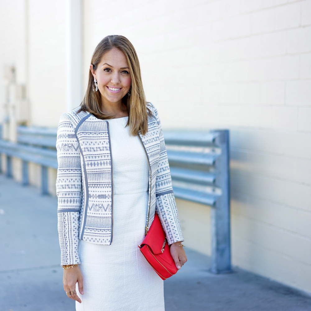 Patterned jacket, white dress, red clutch