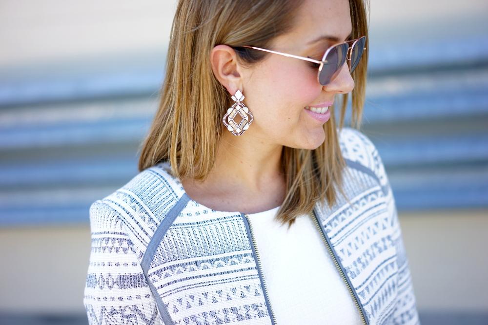 White earrings, patterned jacket, white dress