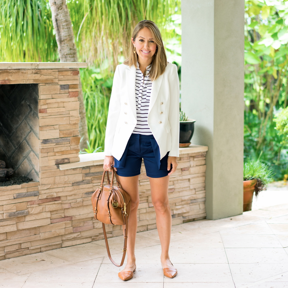 White blazer, striped top, navy shorts
