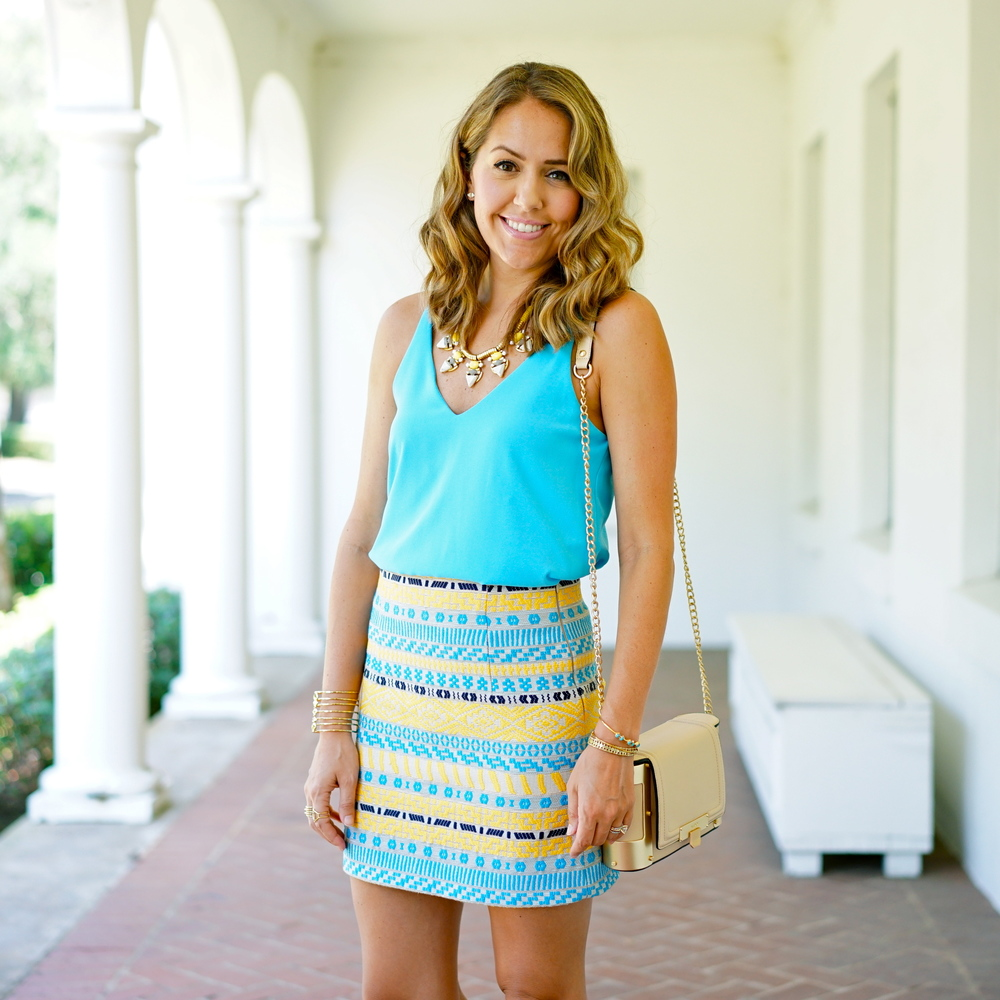 Bright blue top, yellow necklace, tribal skirt