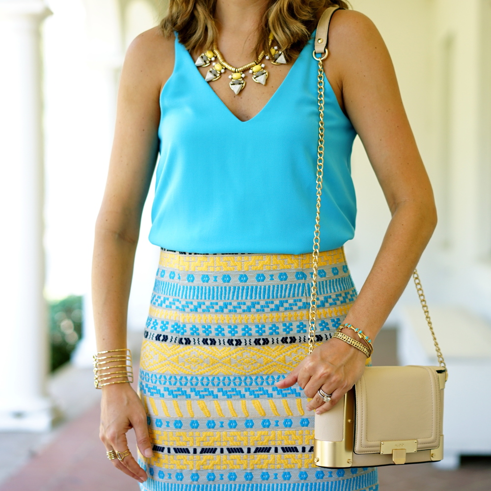 Bright blue top, tribal skirt, yellow necklace