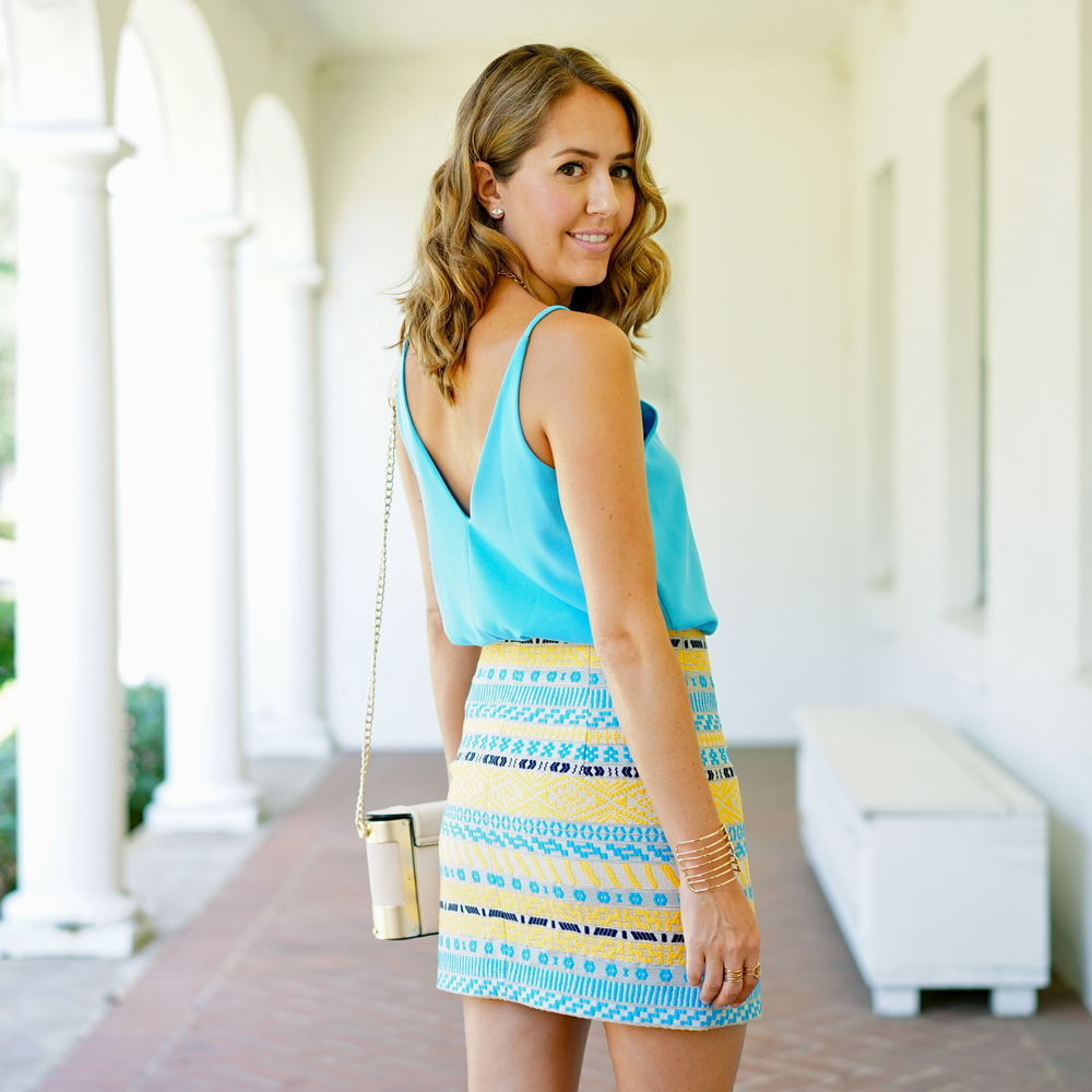 Bright blue top, tribal skirt