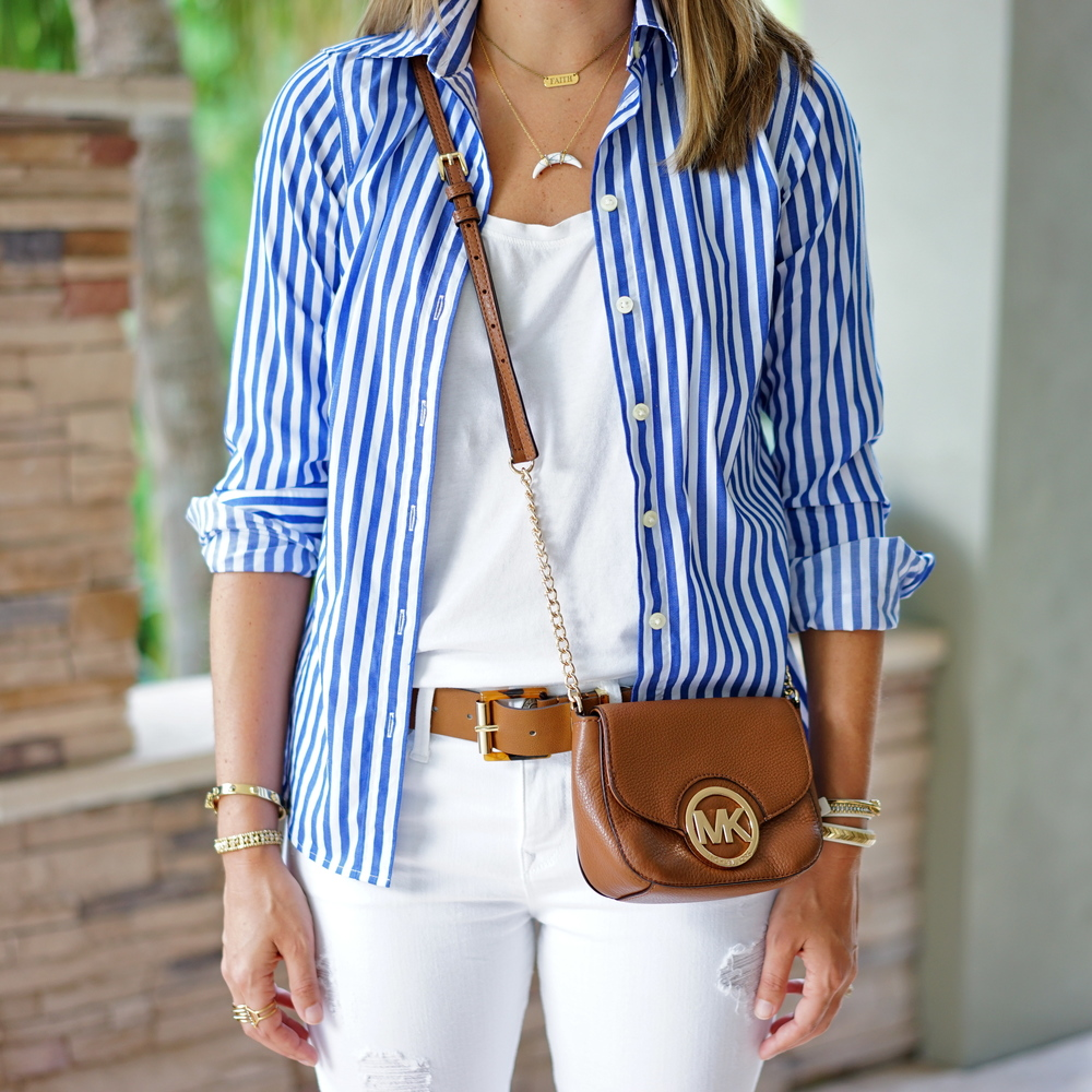 Open blue button front shirt, cognac belt, white jeans