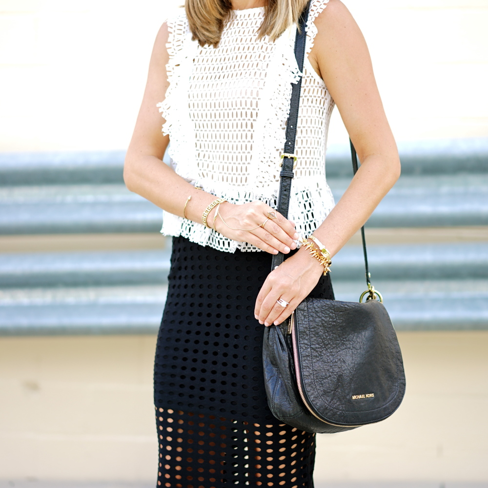 White perforated top with black skirt