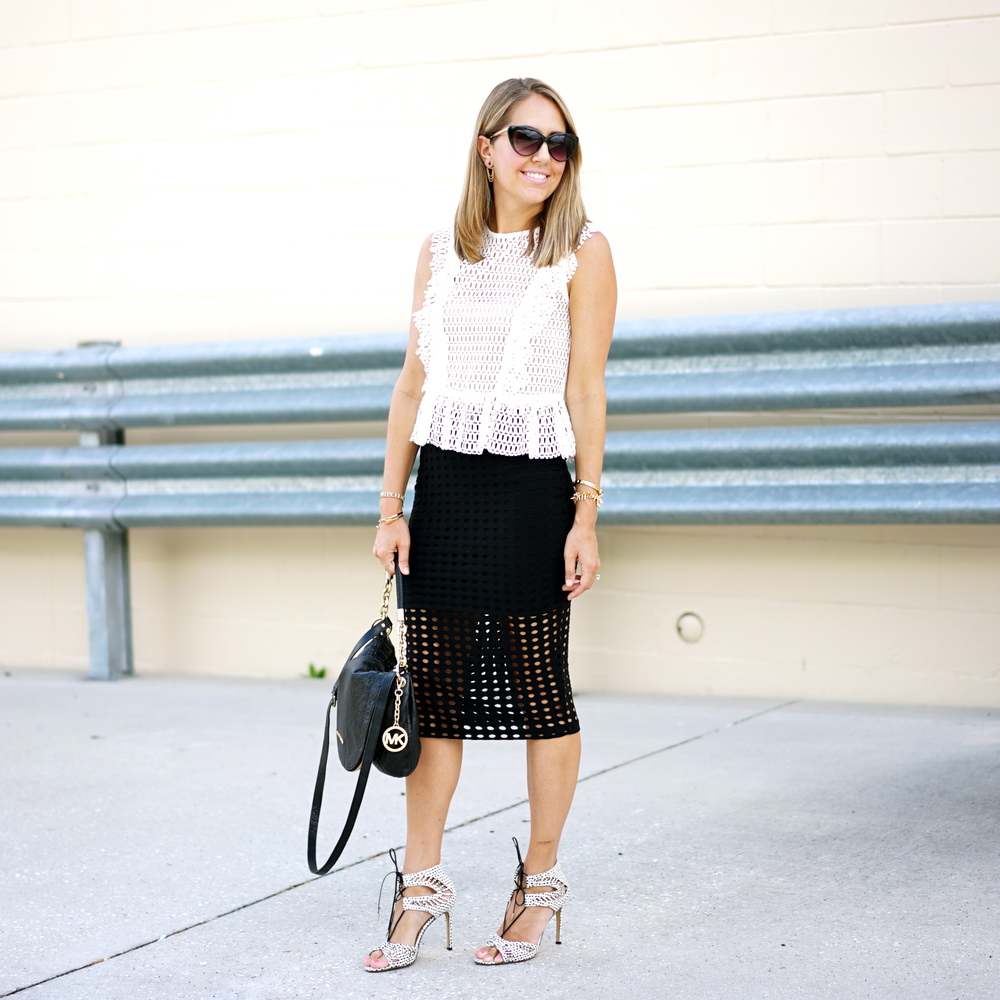 Perforated white top and black skirt