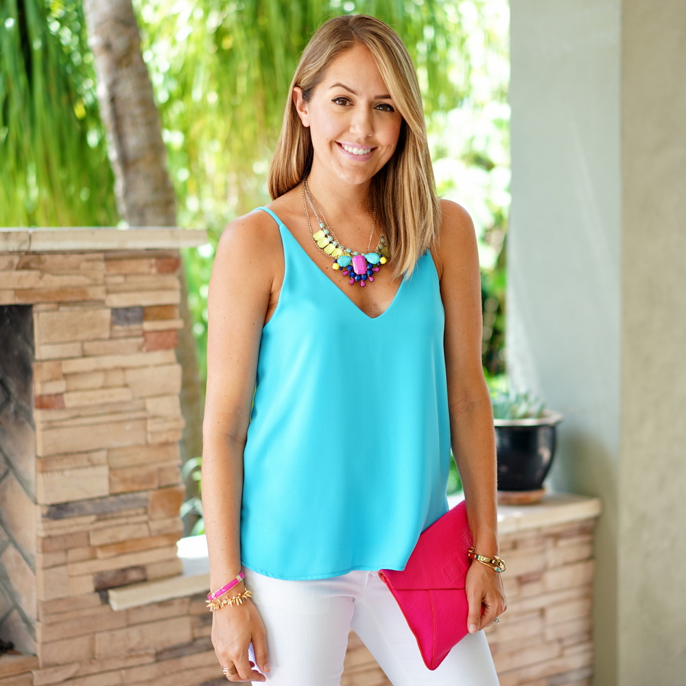 Electric blue v-neck, white jeans, statement necklace