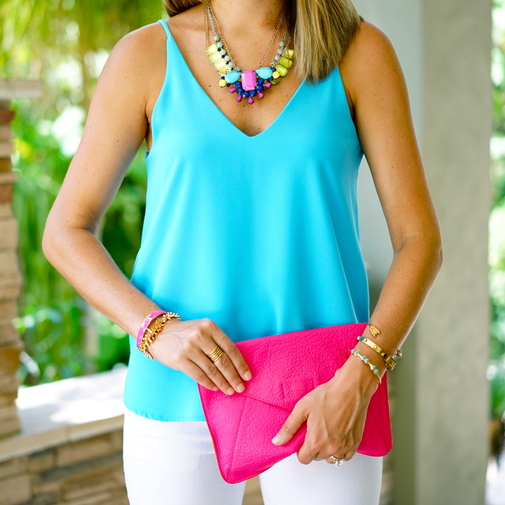 Electric blue tank, pink clutch, statement necklace