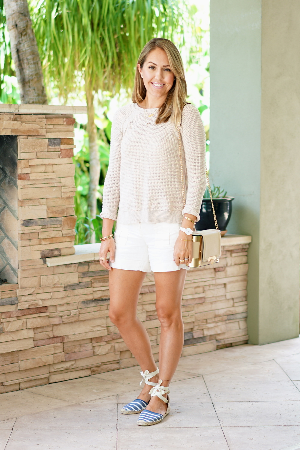 Ivory sweater, linen shorts, striped espadrilles